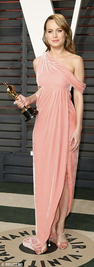 Brie Larson in salmon pink velvet off-shoulder Monse dress that she color-coordinated with her Roger Vivier sandals.