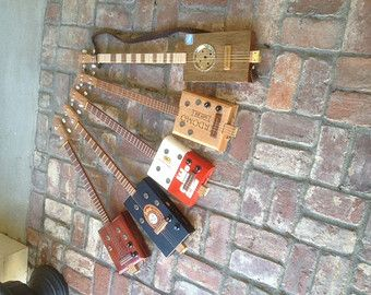 Hand-crafted Cigar Box Guitars. Electric and Acoustic. Made with quality woods, cigar boxes and materials.