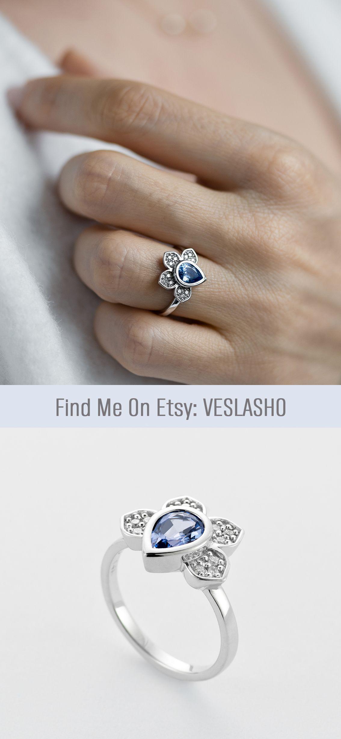 14k white gold white diamond tanzanite lotus flower ring