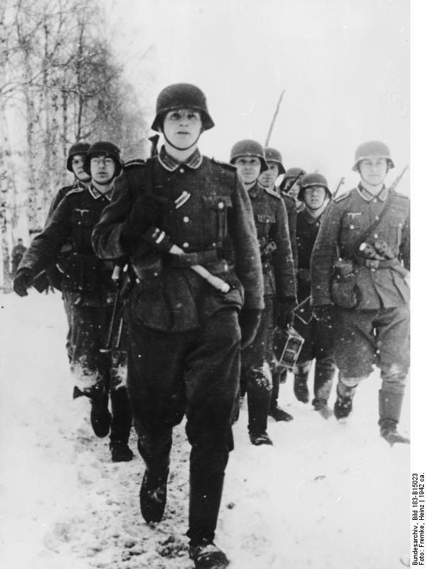 Officer cadets march in the snow during training, 1942 Note the - absence note