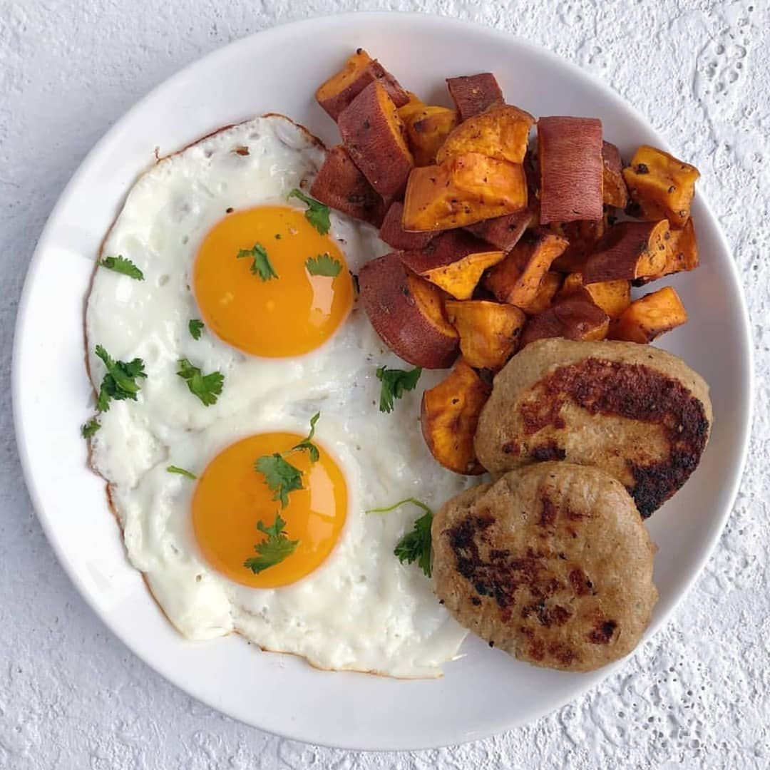 Over easy eggs, roasted sweet potatoes (cooked in avocado oil) alongside duck sausage. Who doesn't enjoy breakfast for dinner??
