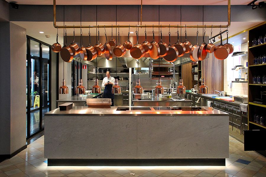 concrete and copper open kitchen at the pressroom restaurant - Restaurant Open Kitchen Design