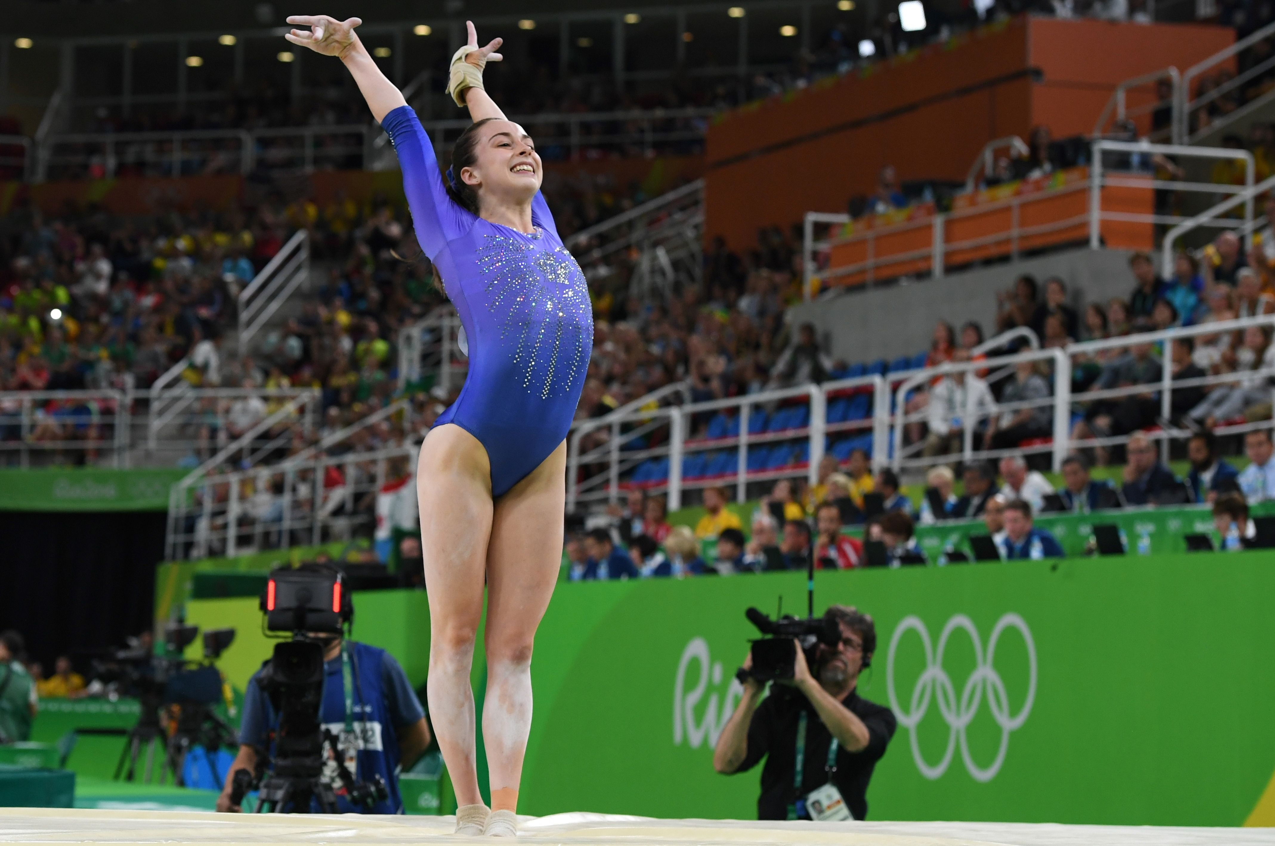 Canadian female gymnast Isabela Onyshko lands after her