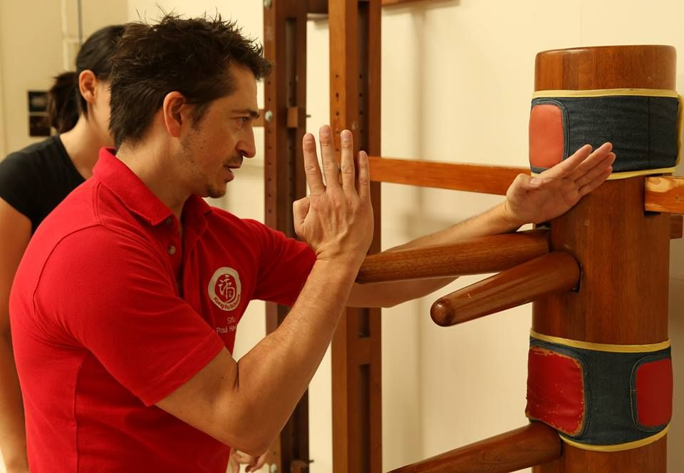 Demonstrating some techniques on the wooden dummy