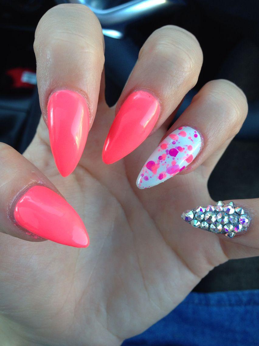 Stiletto acrylic nails; Bright coral, splattered polish ring finger ...