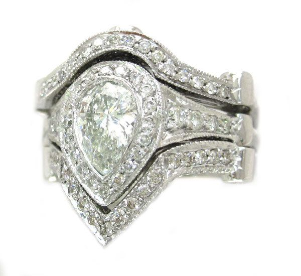 14k white gold pear cut diamond engagement ring and 2 bands bezel set 3.00ctw. $4,899.00, via Etsy.