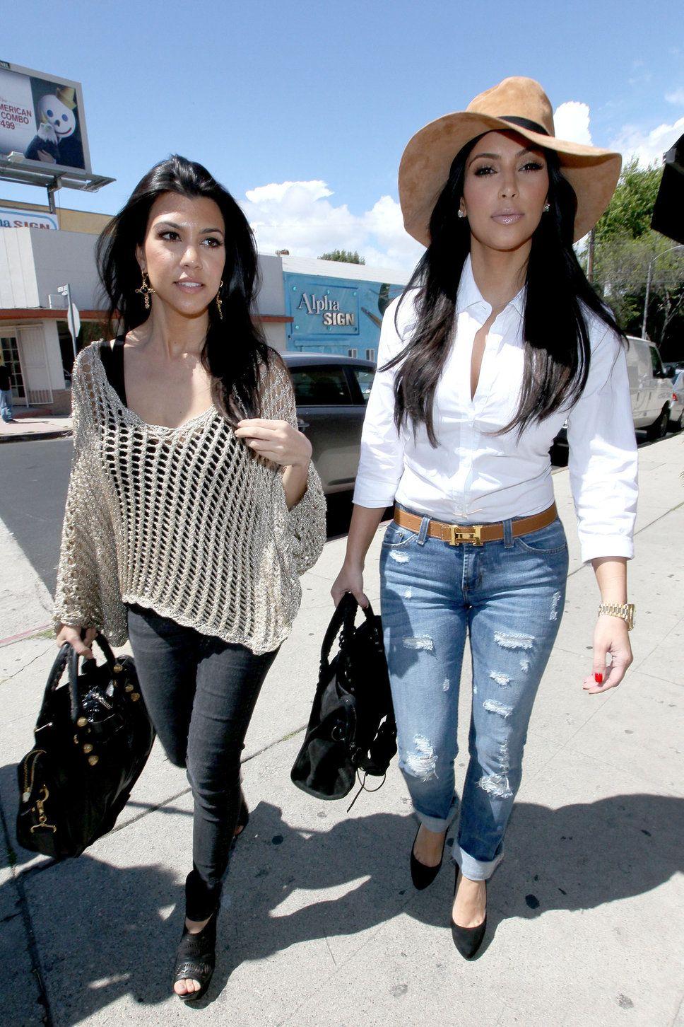 8a0fb6318e6 Kourtney Kardashian and Kim Kardashian sun hat white shirt ripped jeans  black jeans black pumps beige knit sweater paparazzi