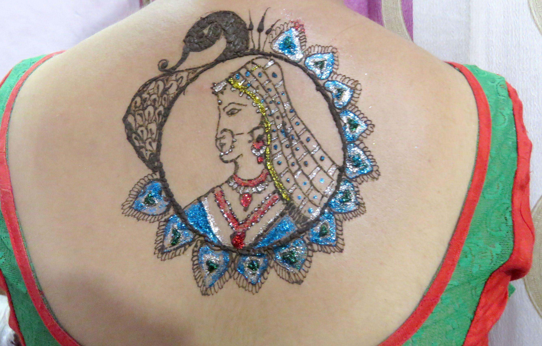 Indian bride tattoo. https://www.youtube.com/watch?v=p2UsBnbAm88