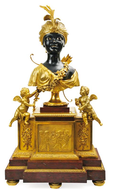 """Pendule de nubienne enturbannée, bronze ciselé et doré, époque Louis XVI, mouvement signé de l'horloger Jean-Simons Bourdier. 77 x 42 x 23 cm. La première pendule """"au nègre"""" qui soit datée fut livrée en 1784 pour Marie-Antoinette. Il est intéressant de noter qu'il ne s'agit pas d'un « nègre » mais d'une « négresse » dont plusieurs exemplaires sont connus."""