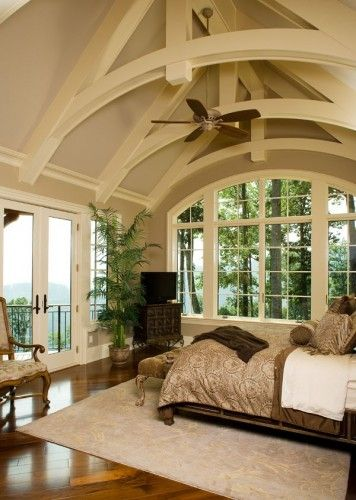 Bedroom with beautiful ceiling and windows
