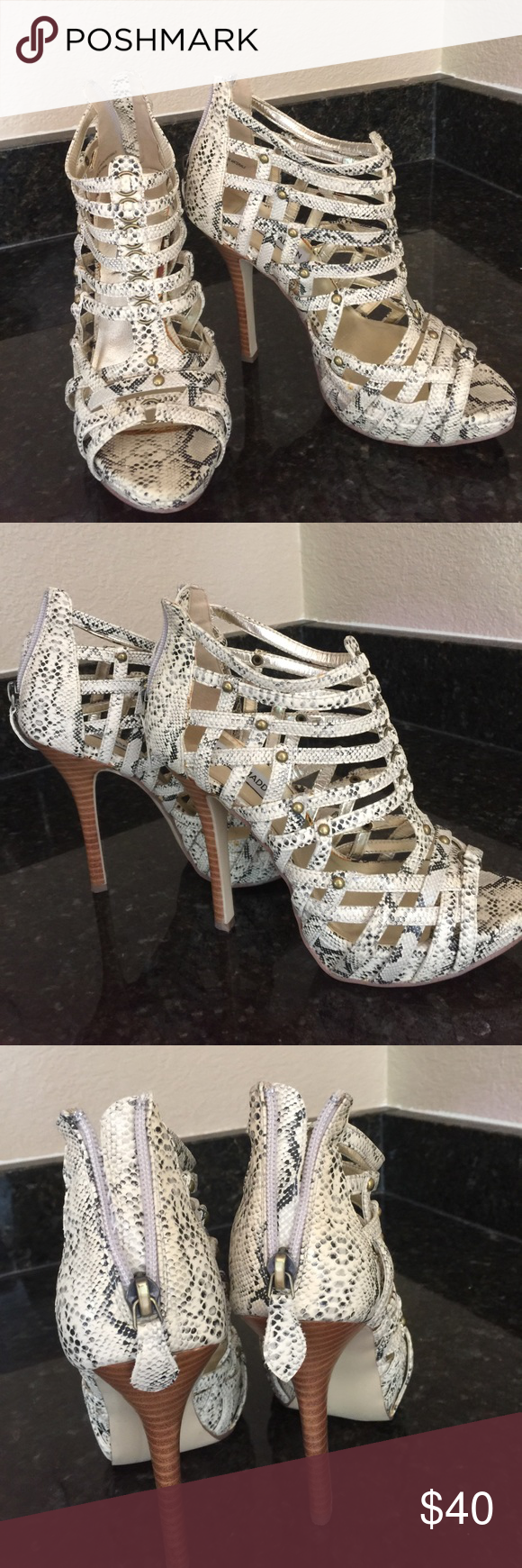 Steve Madden Snake Embossed heels Gently worn vanilla colored caged heels by Steve Madden with snake embossed pattern and a zipper in the back for easy access, they have a light brown stacked heel that will be a beautiful statement shoe for an evening out with the girls or date night! 💕 Gorgeous!🌹 Steve Madden Shoes Heels