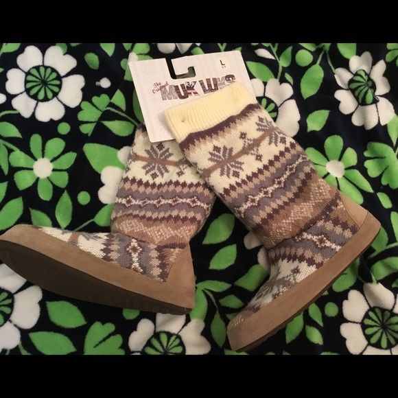 Muk Luks Original Slipper Boots - Size L 8-9 NWT This is a brand new with tags pair of The Original Muk Luks slipper boots.  Size Larege, 8-9.  Knit is 100% acrylic, lining is 100% polyester fleece, trim is 100% polyester faux suede and sole is textile covered TPR.  Super soft & comfy! Muk Luks Shoes Slippers