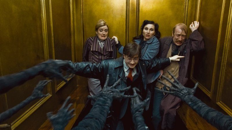 Kate Fleetwood, Daniel Radcliffe, Steffan Rhodri and Sophie Thompson in Harry Potter and the Deathly Hallows: Part 1