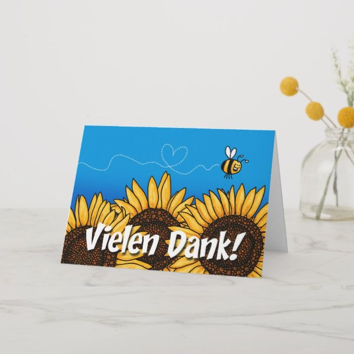 Vielen Dank (thank you very much in German) - A cute bee flies over a row of sunflowers and leaves a heart-shaped trail on this fun and colorful greeting card