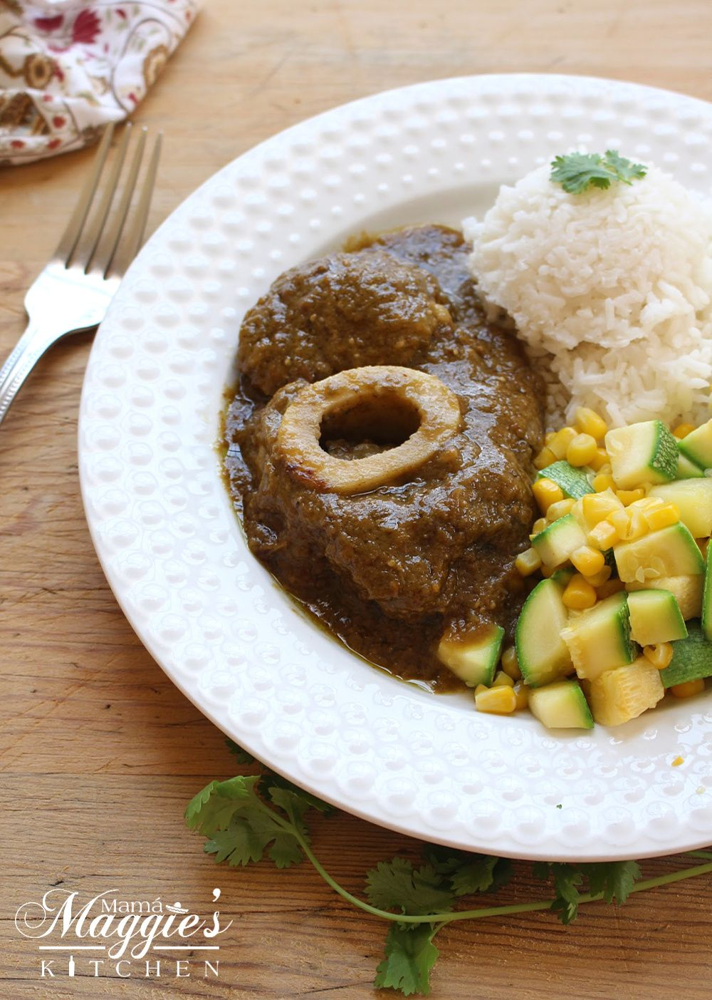 Chamorro En Salsa Verde Or Beef Hind Shank In Mexican Green Sauce On A White Plate With Veggies And Rice On A Wooden Su Mexican Food Recipes Food Salsa Verde