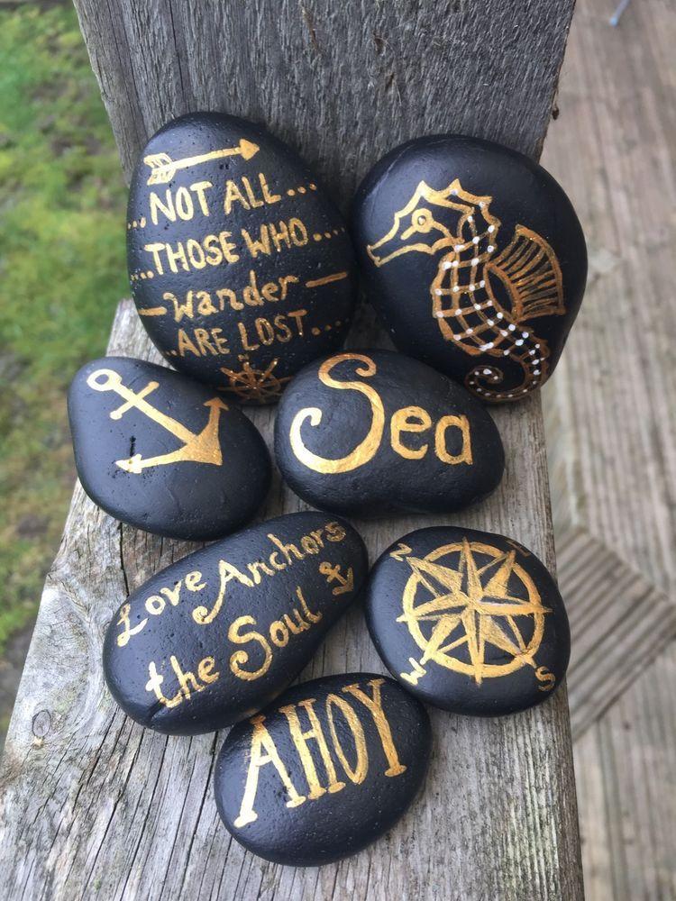Nautical Set Of 7 Black And Gold Painted Pebbles Ebay Pebble Painting Painted Rocks Diy Painted Rocks Craft