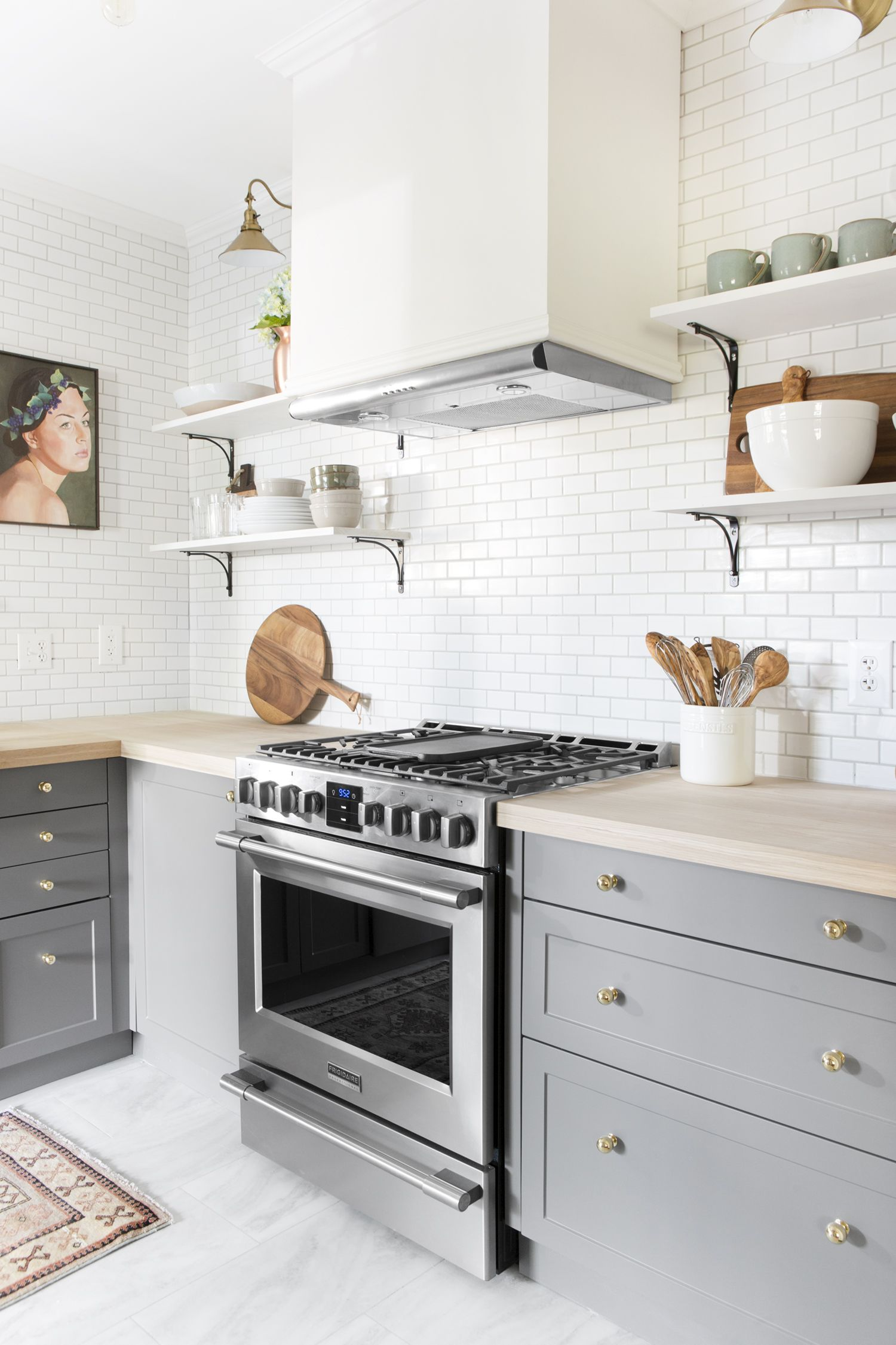 Small Kitchen With White Backsplash And Gray Cabinents Kitchen
