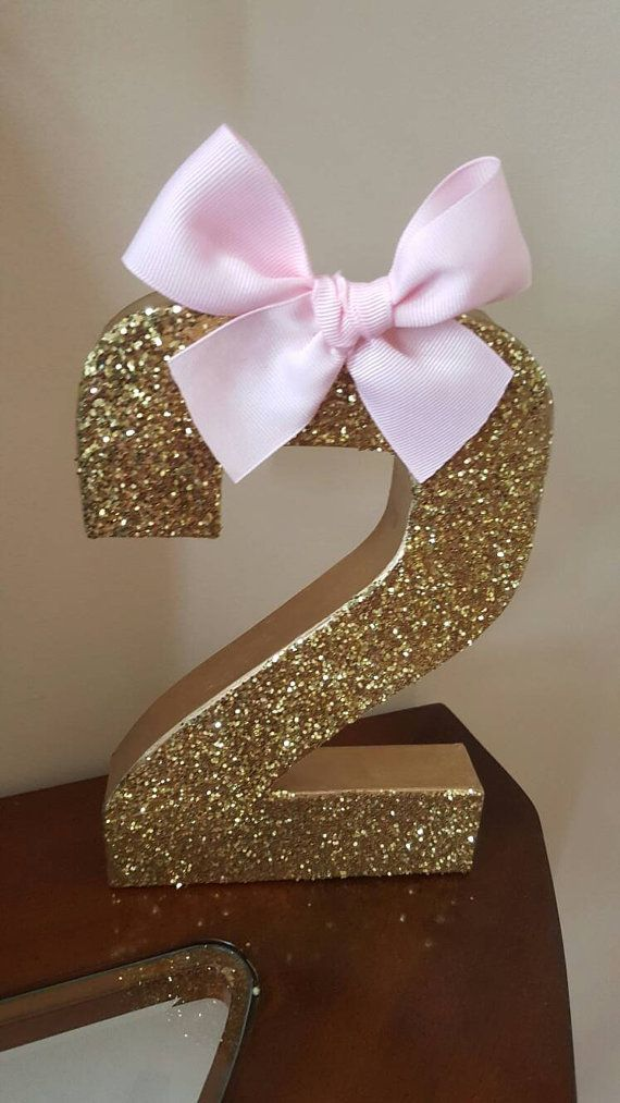 Gold glitter and pink bow age centerpiece party