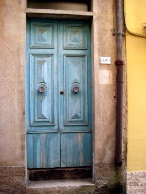 Blue door in small town Italy