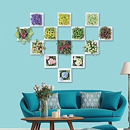 La pared cuelgan flores artificiales planta artificial en marco de ...