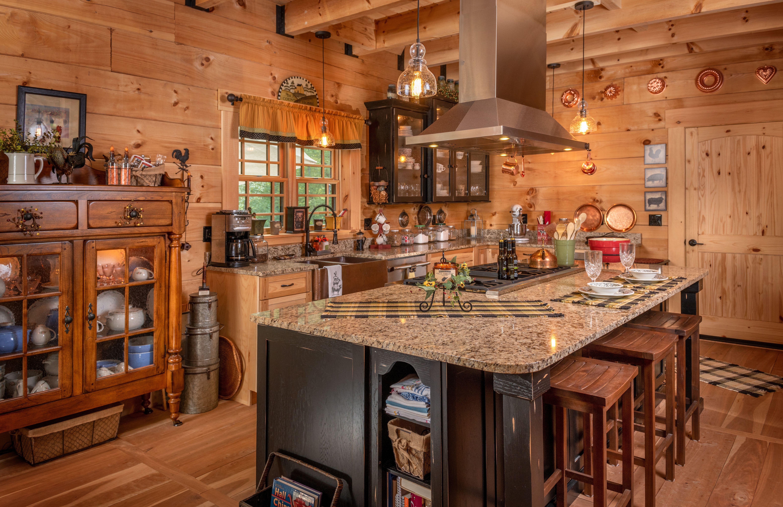 Beautiful Log Home Kitchen With Black Distressed Island Custom