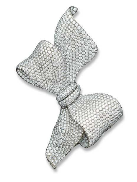 A RARE AND IMPRESSIVE DIAMOND AND TITANIUM BOW BROOCH, BY MICHELE DELLA VALLE  The undulating ribbon bow pavé-set throughout with brilliant-cut diamonds, mounted in titanium, 11.5 cm. long, in Michele della Valle black fitted case  Signed Michele della Valle, No. 07063