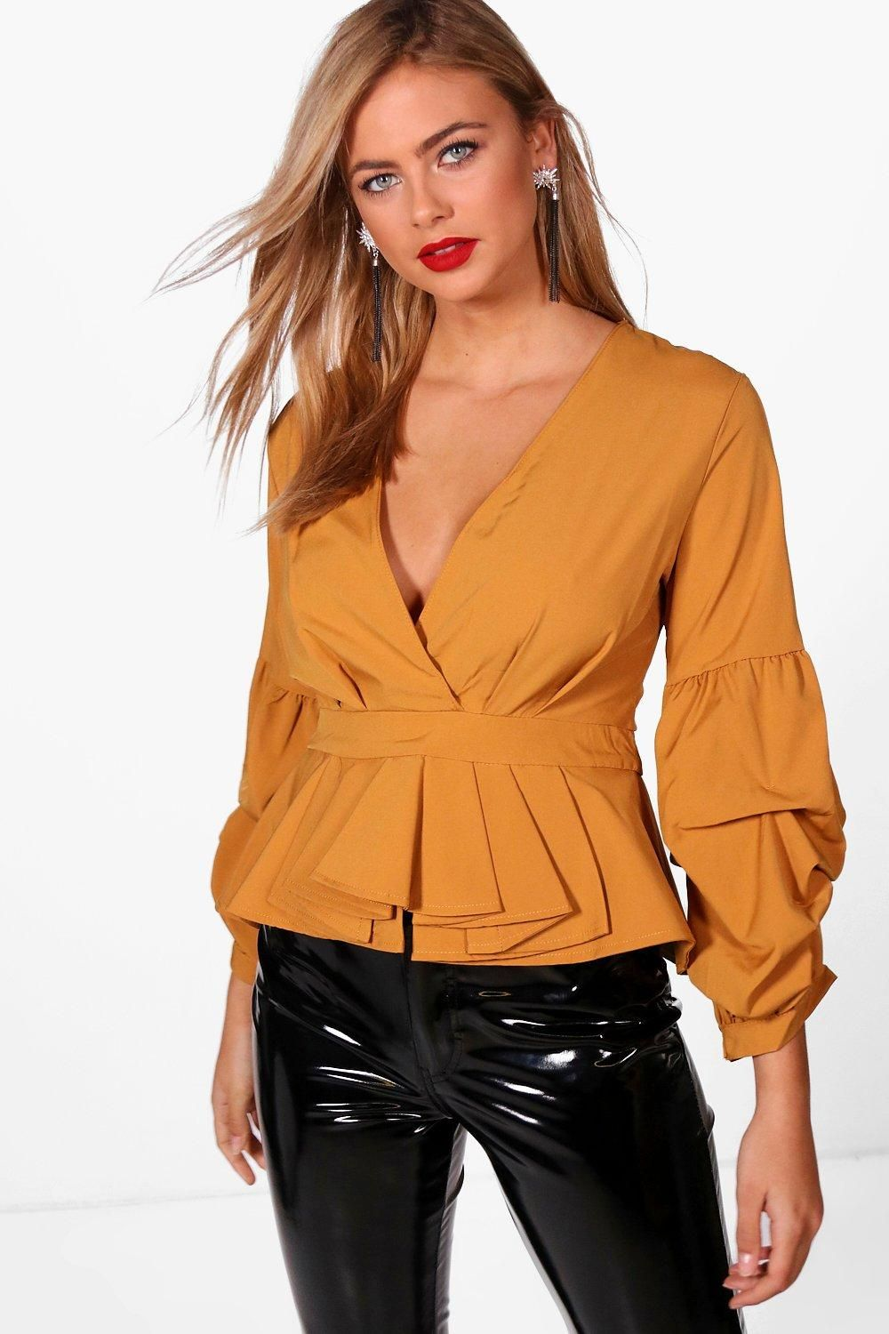 145c44a923b Click here to find out about the Melanie Volume Puff Sleeve Blouse from  Boohoo