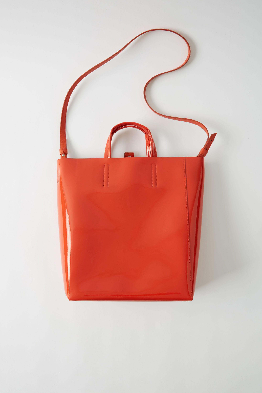a3c978aef7d Acne Studios Baker Patent M Orange Tote bag | Sartorial in 2019 ...