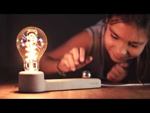 Li.Mod.Mag.T Table lamp with innovative switch that works by moving or scrolling a magnetic ball.