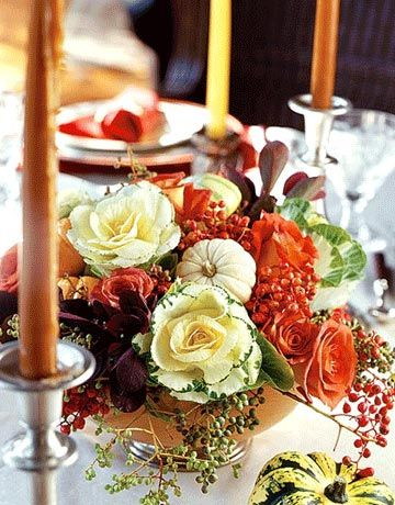 an arrangement of orange and white roses