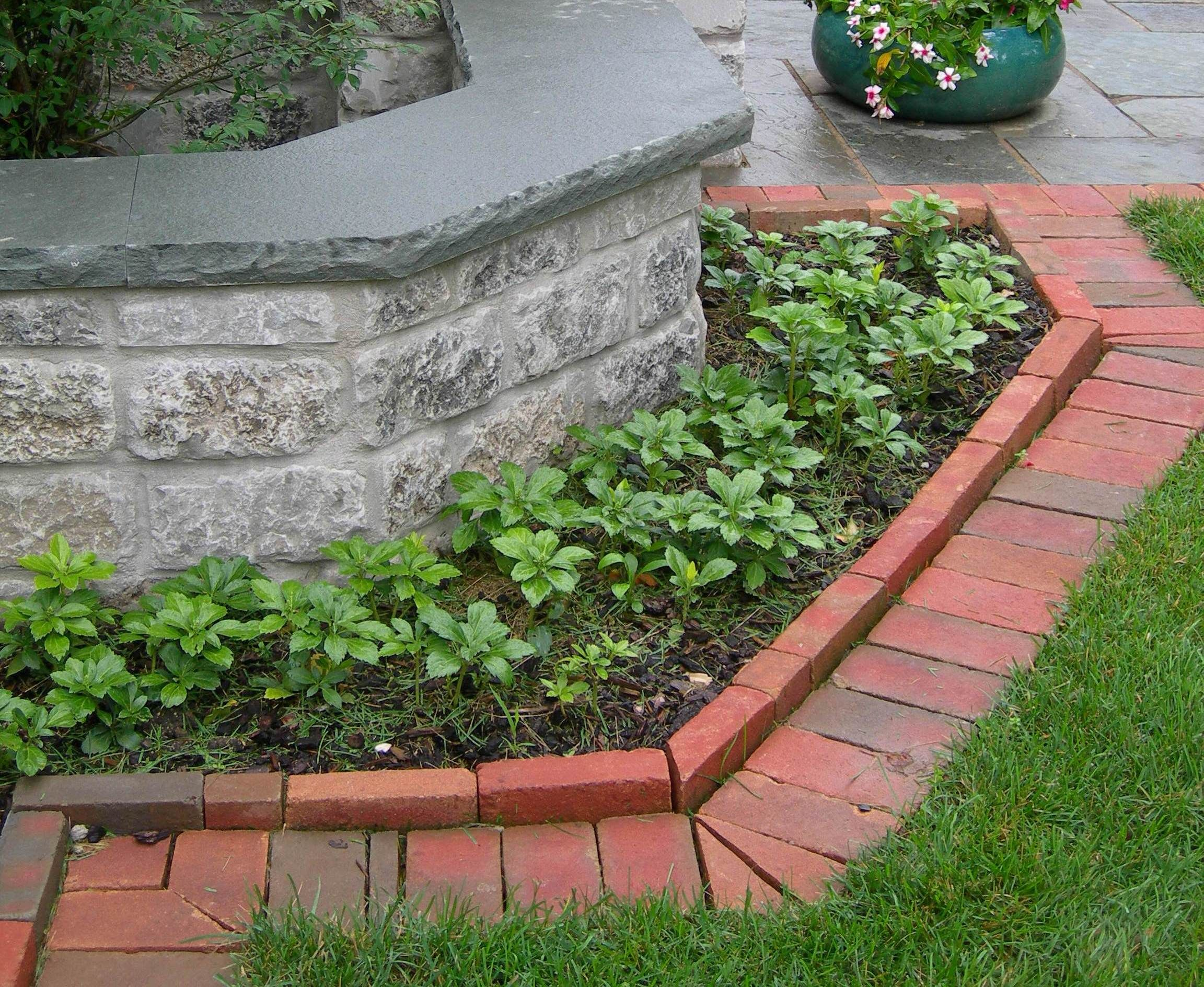 Brick edging mimics the wall | Decorative Landscape Edging ...