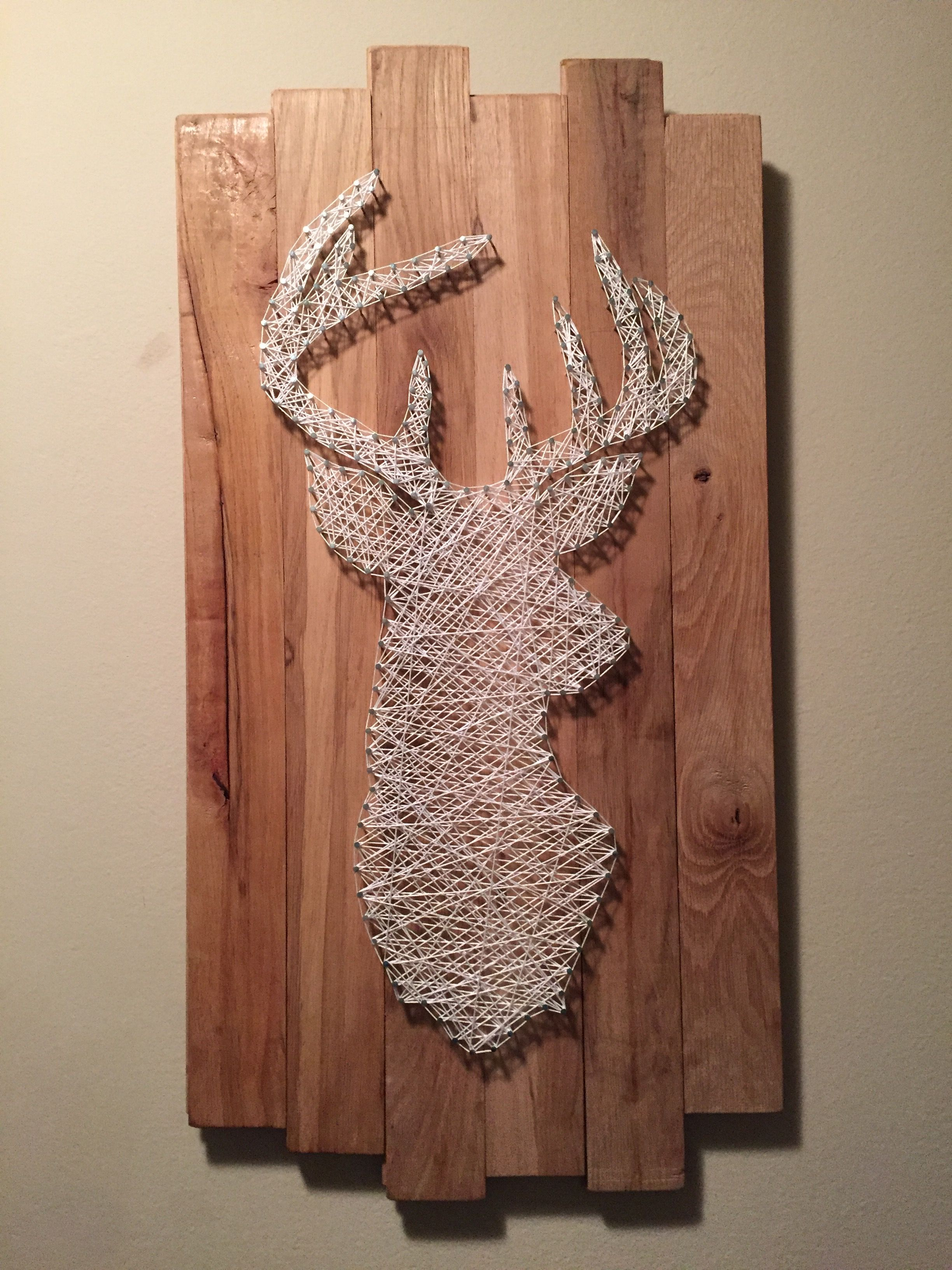 Deer Head String Art Mounted On Hardwood Flooring
