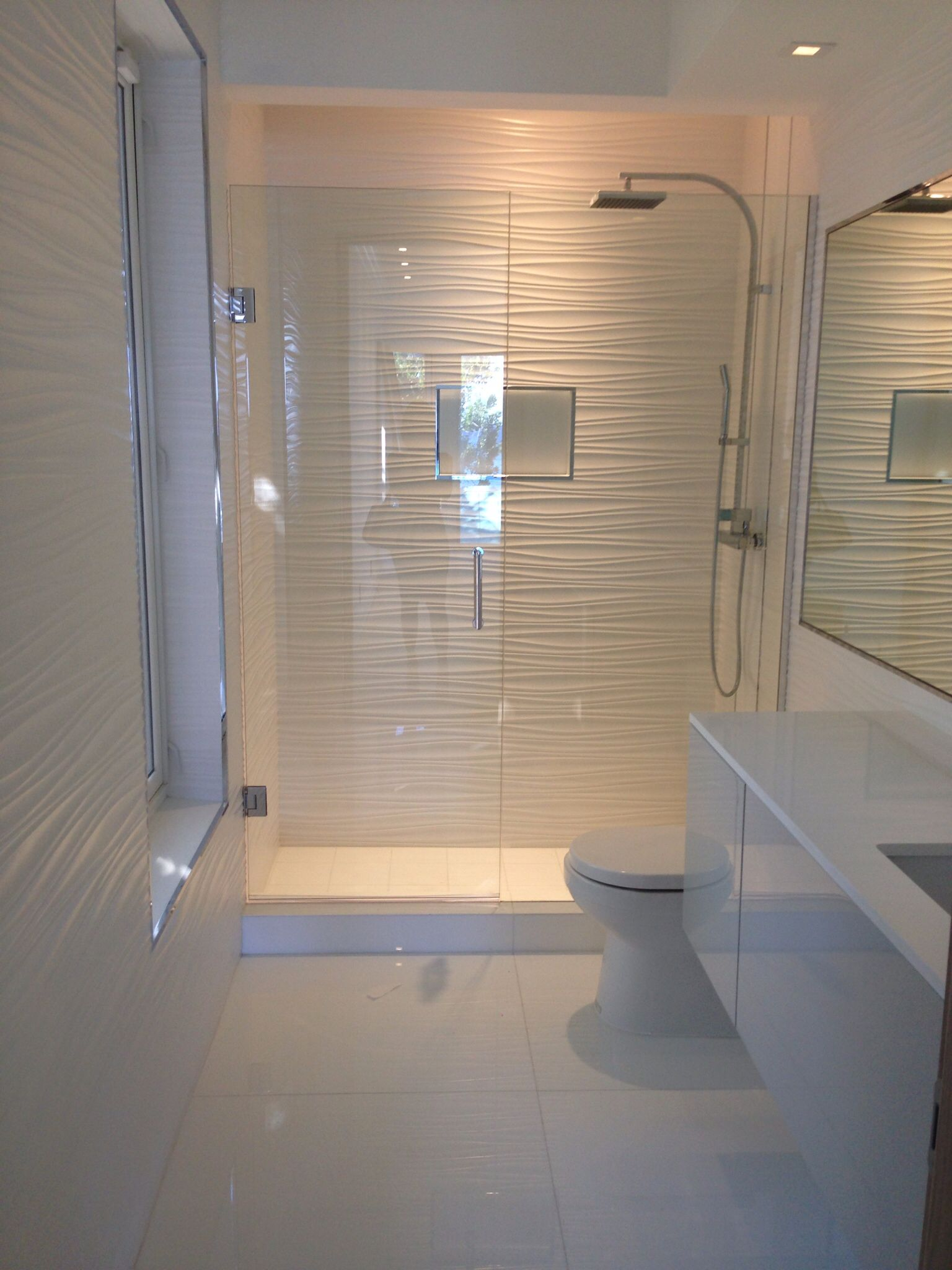 Textured bathroom walls - All White Bathroom Wall Tile Toilet Vanity And Shower Column By Porcelanosa