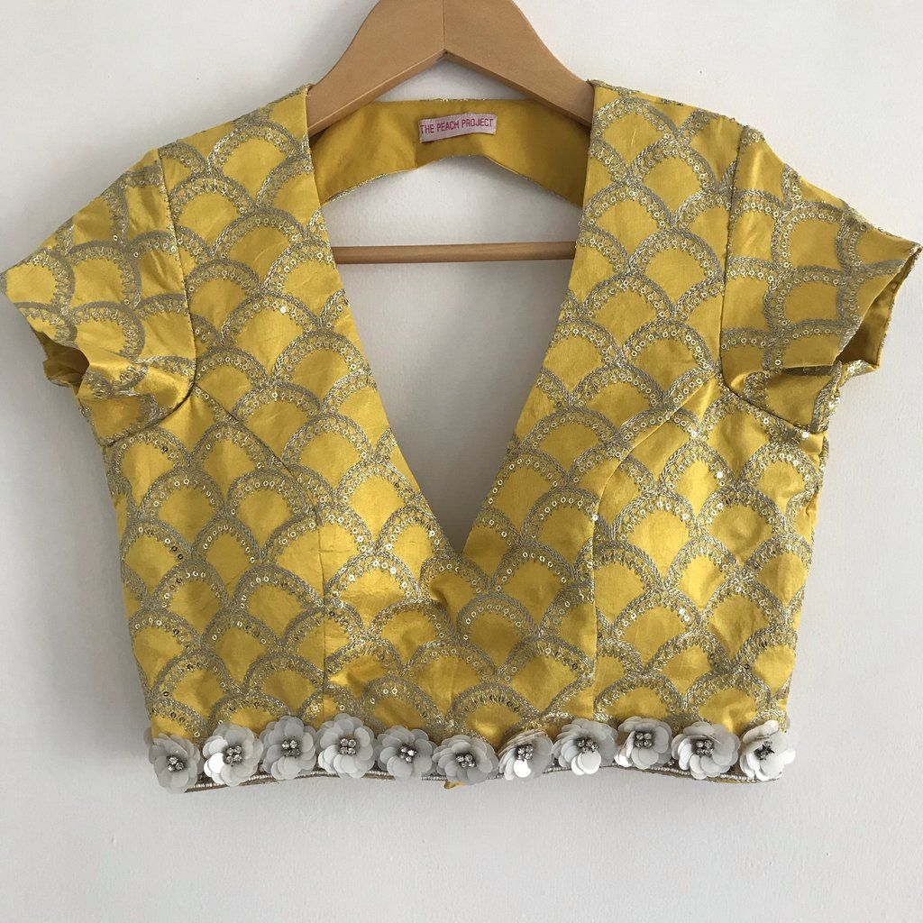 Fishscale patterned blouse in sunny yellow embellished with zari embroidery all over and finished w