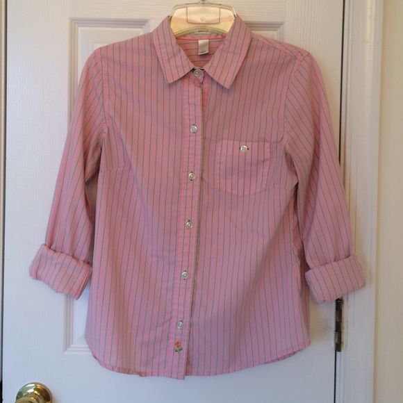 "Women's button down shirt Cute pink button down shirt with green stripes. Old Navy ""perfect fit"" shirt. Great condition, very comfortable and cute with sleeves rolled up or under a contrasting sweater. Old Navy Tops Button Down Shirts"