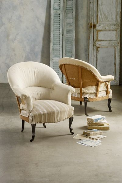 Crafted in the Napolean III style, these Montauban Armchairs With Casters feature solid muslin and natural ticking stripes.