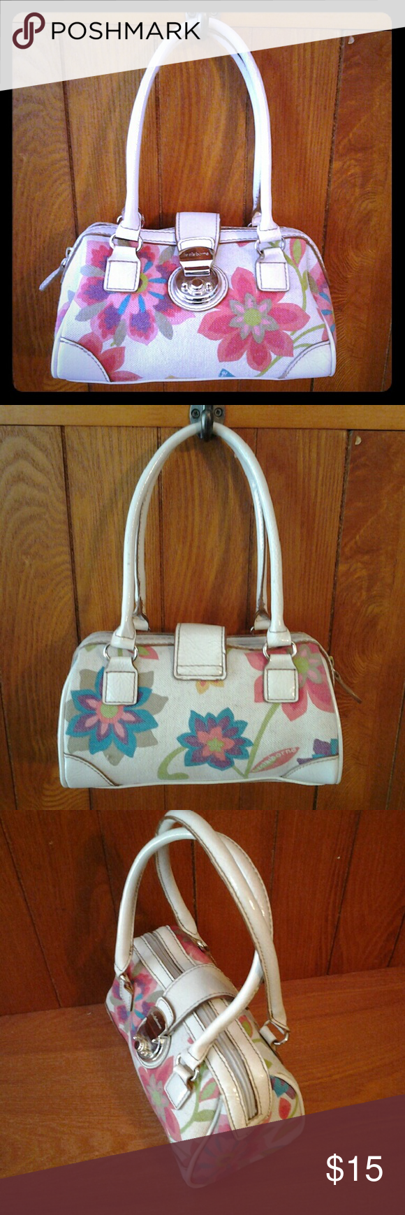 Small White Liz Claiborne purse With Floral Print White trim, fkoral print canvas decor. Gently used, in good condition. No stains, holes, or worn spots.  Zipper pocket inside.  Length 8 1/2 , 4 1/2 in high, 4 1/2 wide, 5 in high double handle. Liz Claiborne Bags Mini Bags