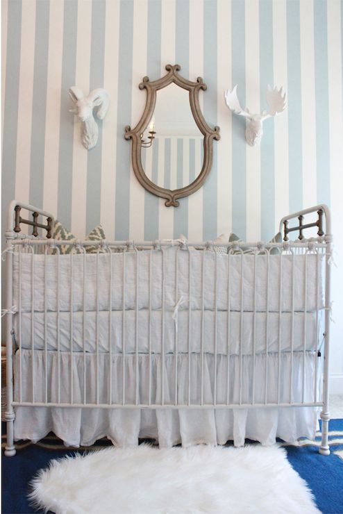 White and blue boy's nursery features blue and white