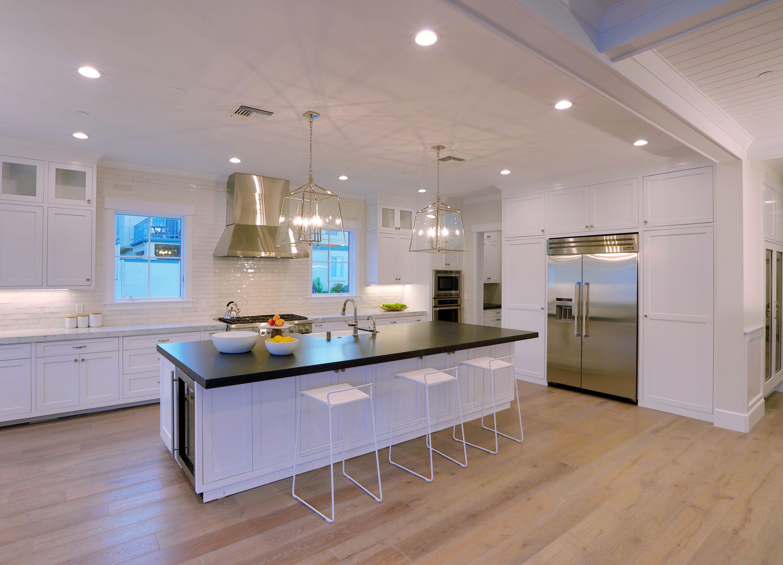 Modern Luxury White Kitchen With Black Island Top Luxury Kitchens Modern Luxury Manhattan Beach