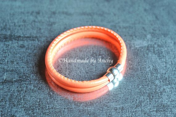 Orange color double bracelet with silver colored magnetic by Anchy