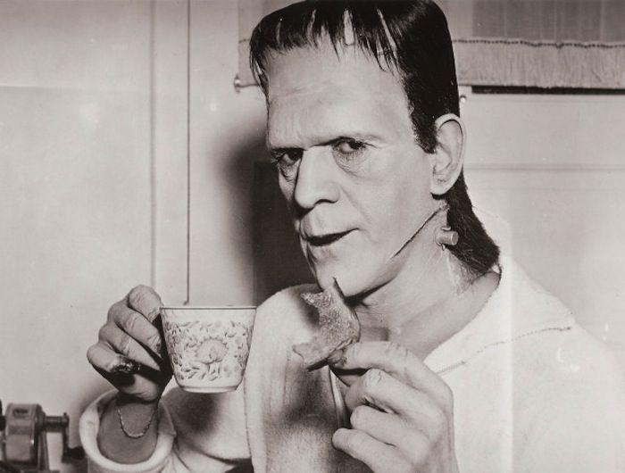 Frankenstein, 1931. Boris Karloff is caught taking a break while in costume.