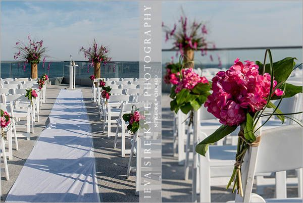 Oceanfront rooftop ceremony at the allegria hotel for Hotel wedding decor