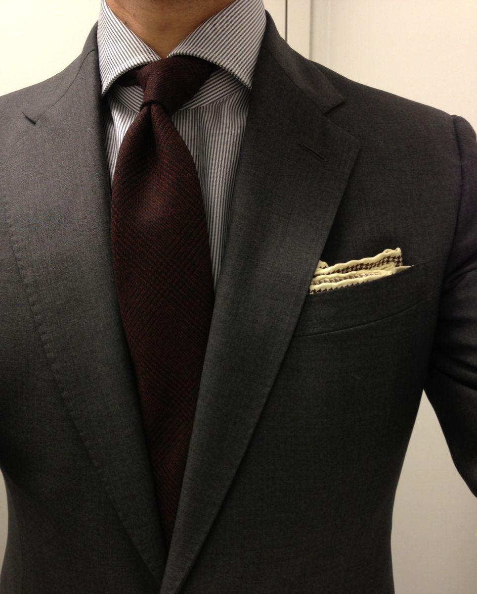 Dark grey suit, white shirt with grey dress stripes, burgundy tie ...