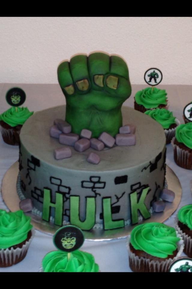 An Incredible Hulk themed cake featuring a hand made Hulk fist and