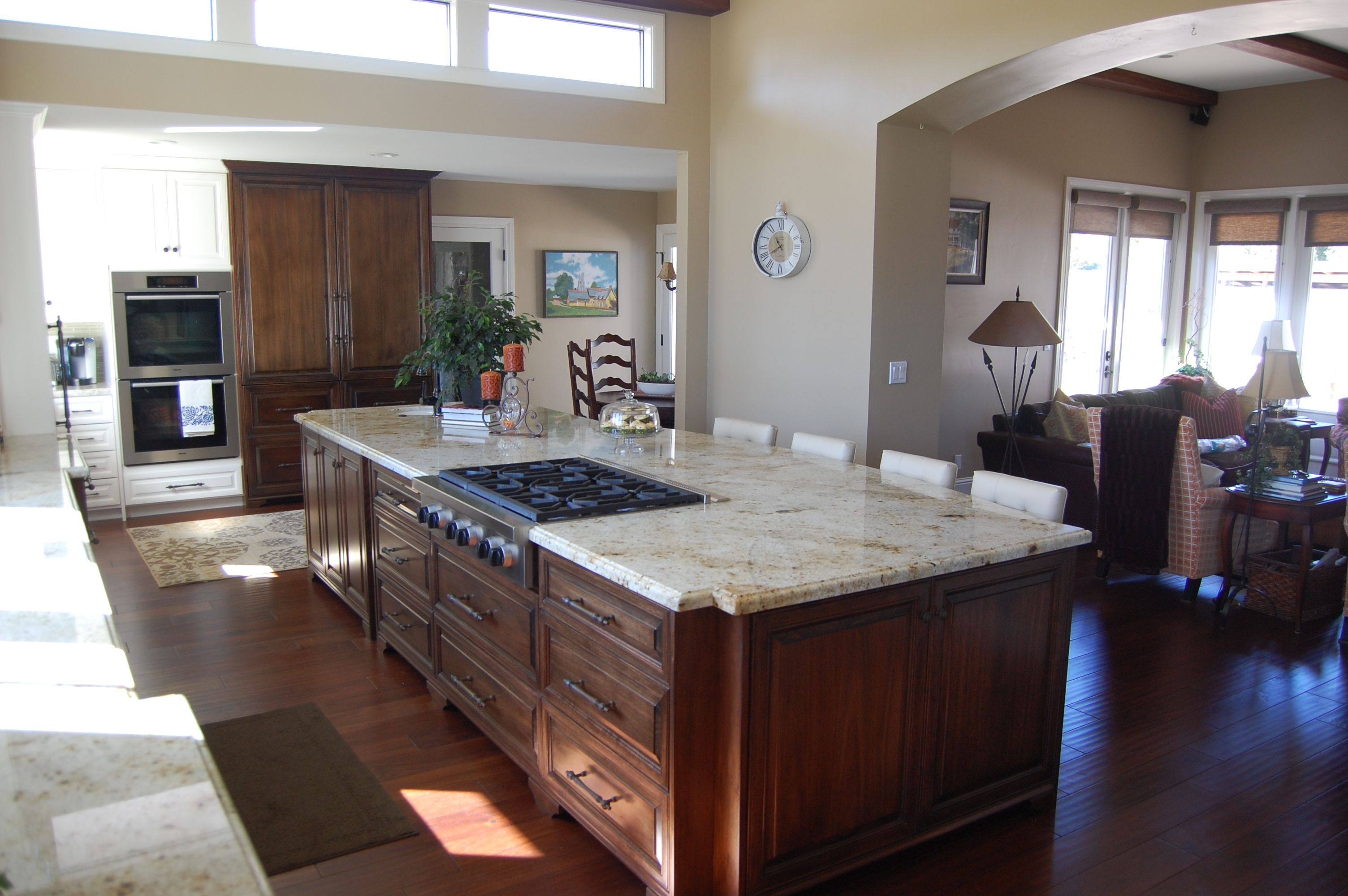 Large Kitchen Islands With Granite Top Large kitchen island with wood cabinets, a granite countertop, and a built  in oven