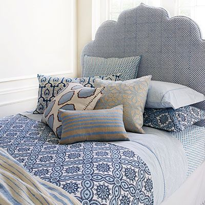 Exotic and rich prints on sheets, quilts, and pillows are a hallmark of designer John Robshaw's line. | Coastalliving.com