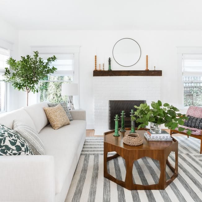 Transitional Living Room Features Unique Fireplace