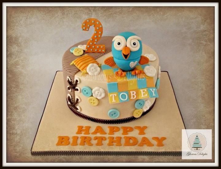 Blue owl cakewith fabric and button elements Decorated Cakes