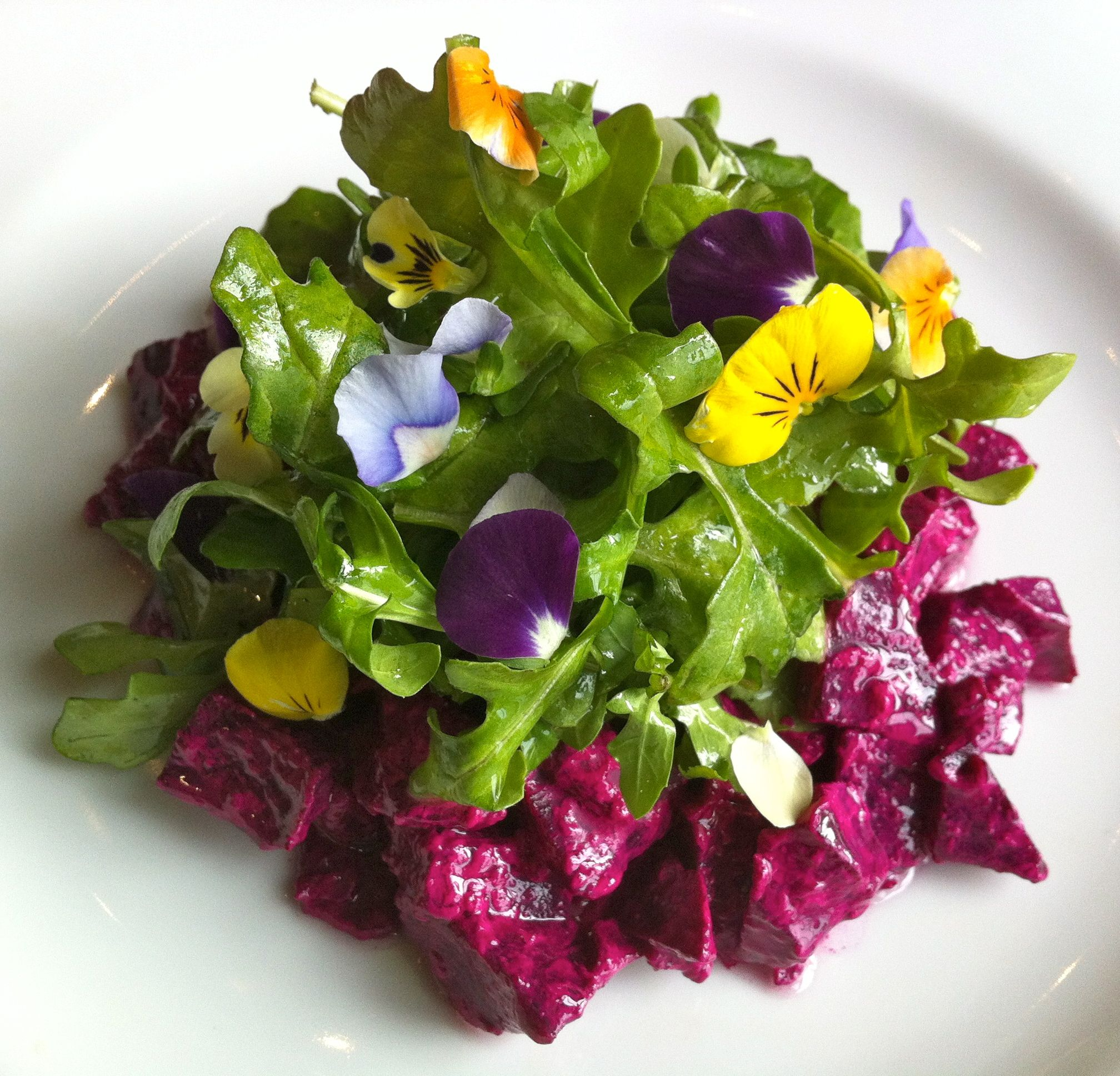 Mother Earth salad at Unforked in Overland Park, Kansas (ATE).  roasted beets marinated in creamy tarragon dressing topped with baby arugula (tossed in flaxseed oil) & edible flowers