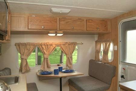 Nice Serro Scotty Sportsman Small Travel Trailer Interior   Front View Showing  Overhead Cabinets